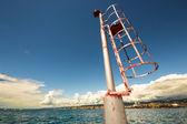 Little beacon on a dock of an Italian city — 图库照片