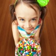 Girl holding a box of candies — Stock Photo #37819851