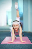 Kid doing fitness exercises — Stock Photo