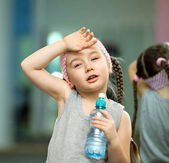Kid tired after fitness exercises — Stock Photo