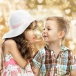 Stock Photo: Little girl kissing boy