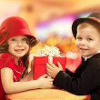 Little boy giving girl gift — Stock Photo #39398971