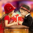 Happy children opening magic gift — Stockfoto