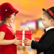 Little boy giving girl gift — Stock Photo