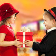Little boy giving girl gift — Stock Photo #39862539