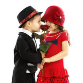 Lovely little boy giving a rose to girl — Stock Photo