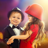 Lovely little boy and girl dancing — Stock Photo