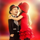 Little boy and girl hugging — Stock Photo
