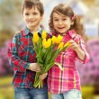 Son with bouquet preparing surprise for mother — Stock Photo #41520689