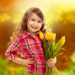 Smiling girl with big bouquet of flowers — Stock Photo