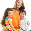 Happy mother with her daughter and son — Stock Photo #42611283