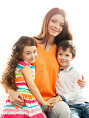 Happy mother with her daughter and son — Stock Photo