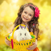 Happy little girl with easter rabbit — Stock Photo