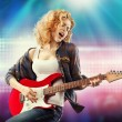 Beautiful woman playing the guitar — Stock Photo