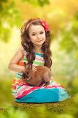 Happy little girl with rabbit — Stock Photo