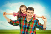 Joyful father with daughter on shoulders — Stock Photo