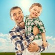 Joyful father with son carefree and happy — Stock Photo #46260859