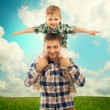 Joyful father with son on shoulders — Stock Photo #46260867