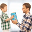 Happy son gives his father gift — Stock Photo #47416919