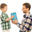 Happy son gives his father gift — Stock Photo #47595329