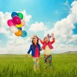 Children with balloons walking on summer field — Stock Photo #47595373