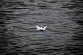 Paper boat floating — Stock Photo