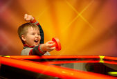 Child during air hockey game — Stock Photo