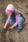 Girl seeding — Stock Photo