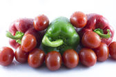 Reds and green peppers — Stock Photo
