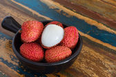Lychee on a wooden table — Stock Photo