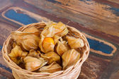 Physalis in basket on wooden table — Stock Photo