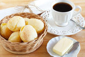 Brazilian snack cheese bread (pao de queijo) with cup of coffee — Stock Photo