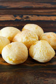 Brazilian snack cheese bread (pao de queijo) in wooden table — Stock Photo