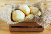 Brazilian snack cheese bread (pao de queijo) in wooden box — Stock Photo