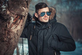 A handsome young man with spectacles in the Park — Stock fotografie