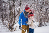 Guy and girl walk and have fun in the forest — ストック写真