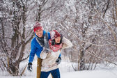 Guy and girl walk and have fun in the forest — 图库照片