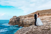 Bride and groom near the ocean — Foto Stock