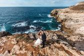 Bride and groom near the ocean — Stock Photo