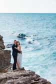 Bride and groom near the ocean — Stock Photo