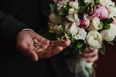 Wedding rings in the hand of the groom — Stock Photo