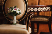 Wedding bouquet on a Chair — Stock Photo