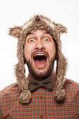 Funny portrait of a man with emotion on her face in the studio — Stock Photo