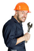 Funny worker in helmet with emotion on her face — Stok fotoğraf