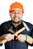 Funny worker in helmet with emotion on her face — Stock Photo