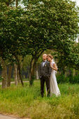 Bride and groom in nature — Stock Photo