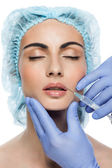 Cosmetic botox injection to the pretty woman face — Stockfoto