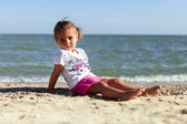 Girl on the beach by the sea — Stock Photo