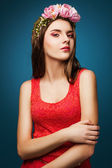 Girl with a wreath of pink flowers on her head — Stock Photo