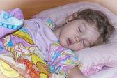 The beautiful girl sleeps. Pink dreams — Stock Photo